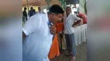 Watch video: BJP MLA arvind raiyani spit in the kitchen at rajkot