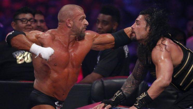 Triple H vs Roman Reigns