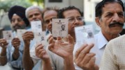 Voters showing their Voter ID