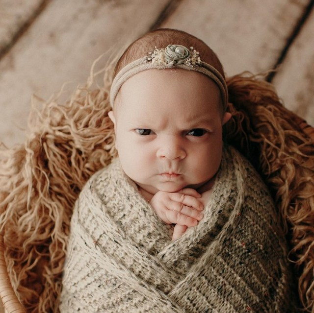 A Newborn Girl Mean Mugs During a Photoshoot, and Her Pics Might Be the Best Thing You'll See Today