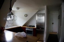 Kitchen and hallway to the entrance. Directly to the left of that door was the bathroom.