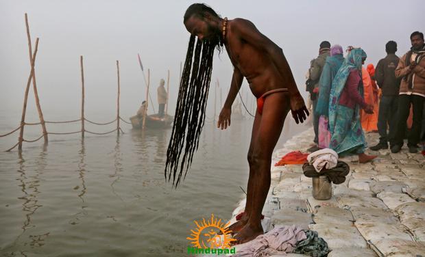 Sadhu performing Snan at Kumbh Mela 2013