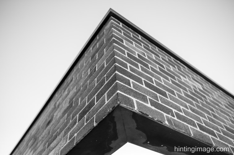 brick cantilever black and white photo