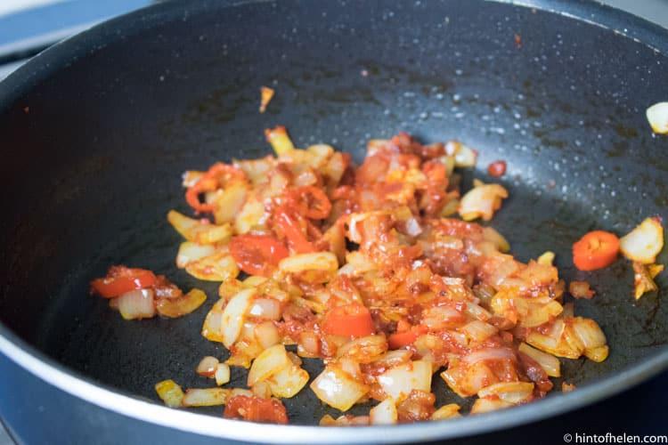 tomato onions and garlic in pan recipe jollof rice