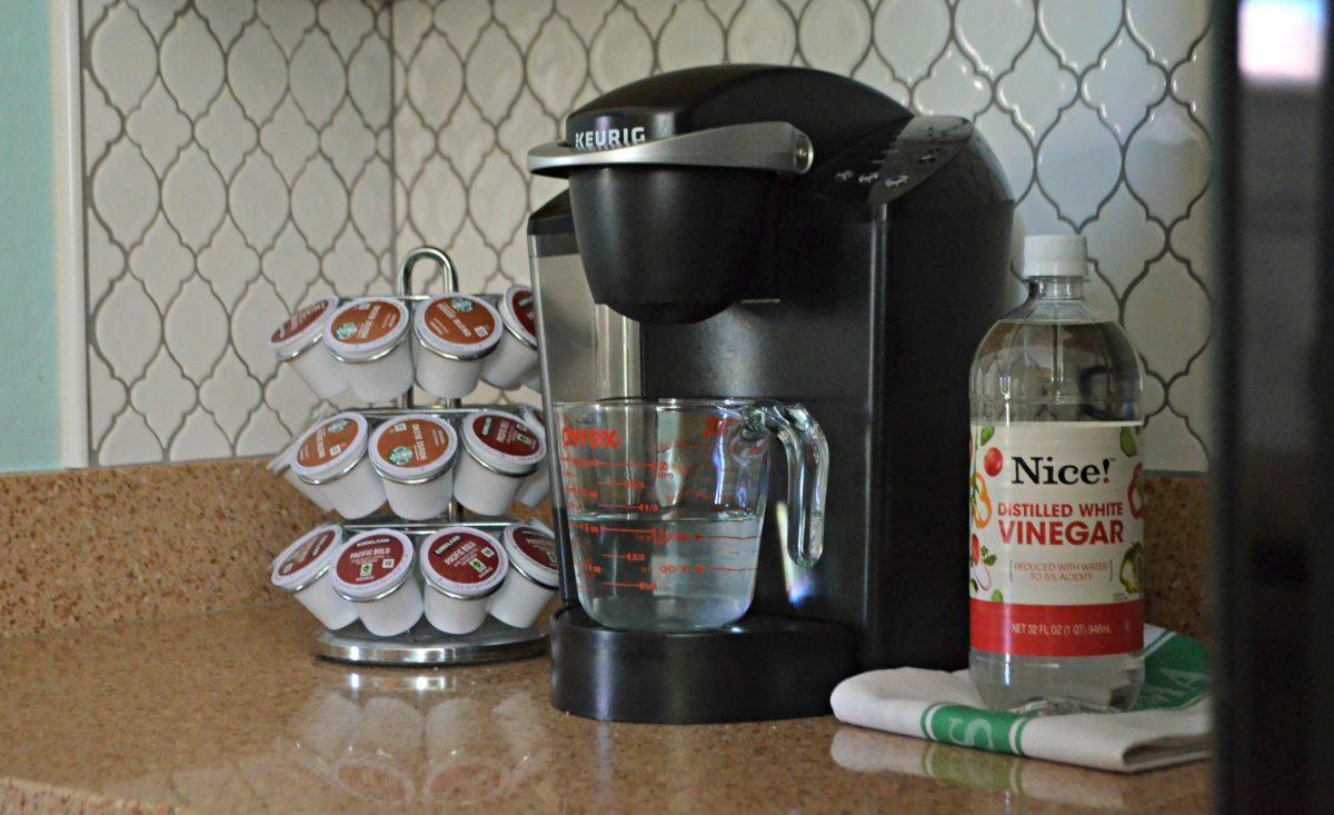 measuring cup sitting on Keurig coffee maker