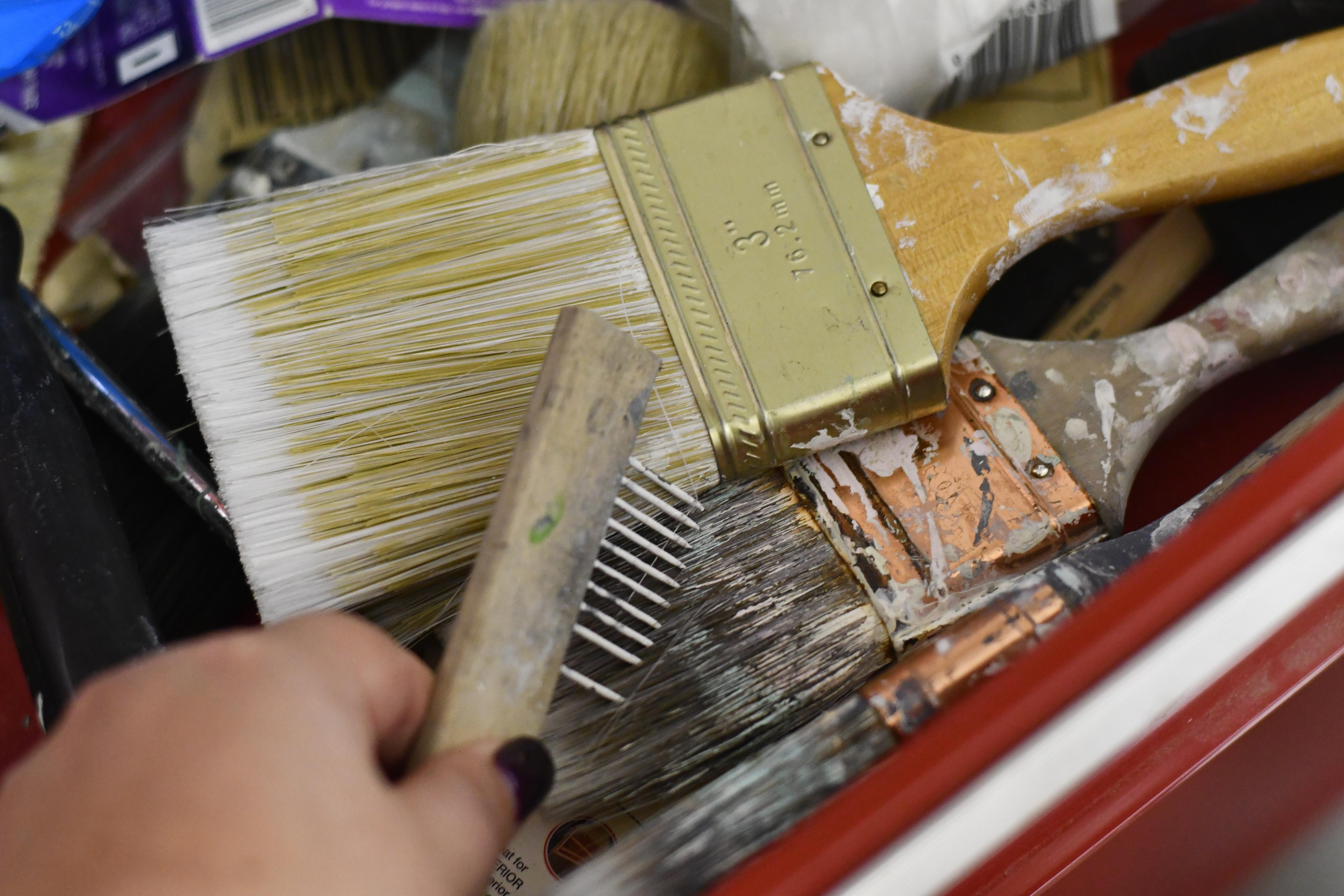 brushing paint brushes