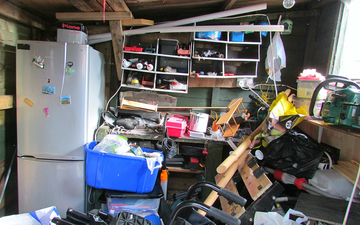 decluttering and organizing with simple home tips — messy garage full of clutter