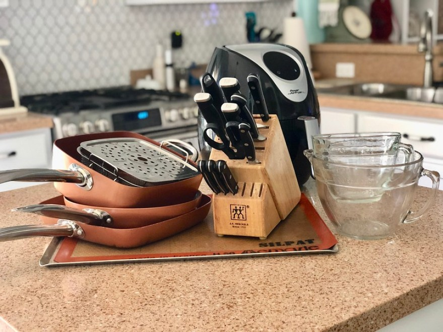 copper cookware, knives, Silpat, and glass measuring cups