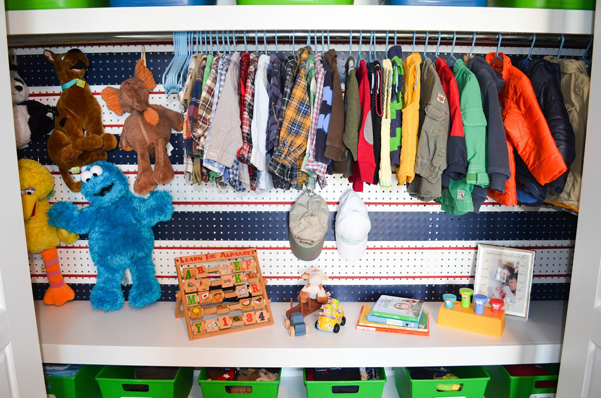 boy's closet organized using peg board wall