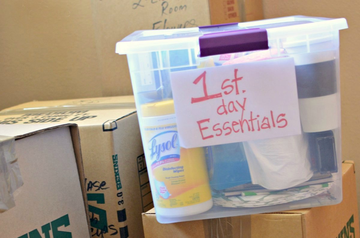 a clear box labeled 1st day essentials