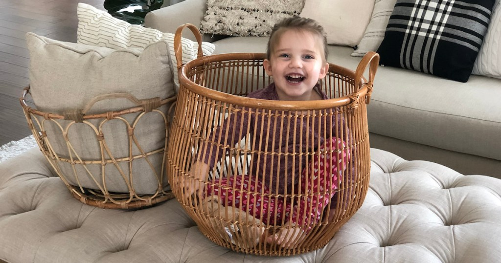 charli sitting inside of a basket laughing