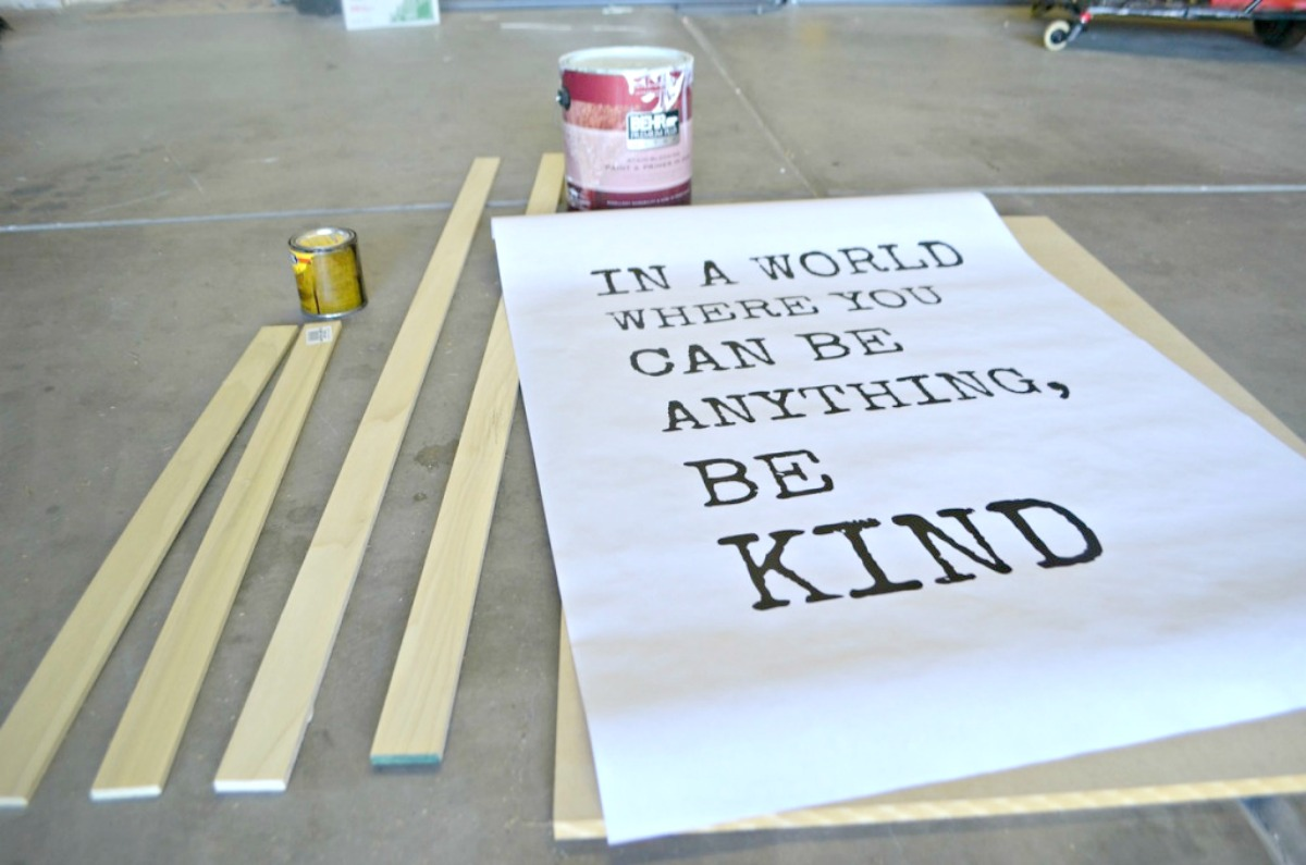 "paper that reads ""in a world where you can be anything, be kind"""