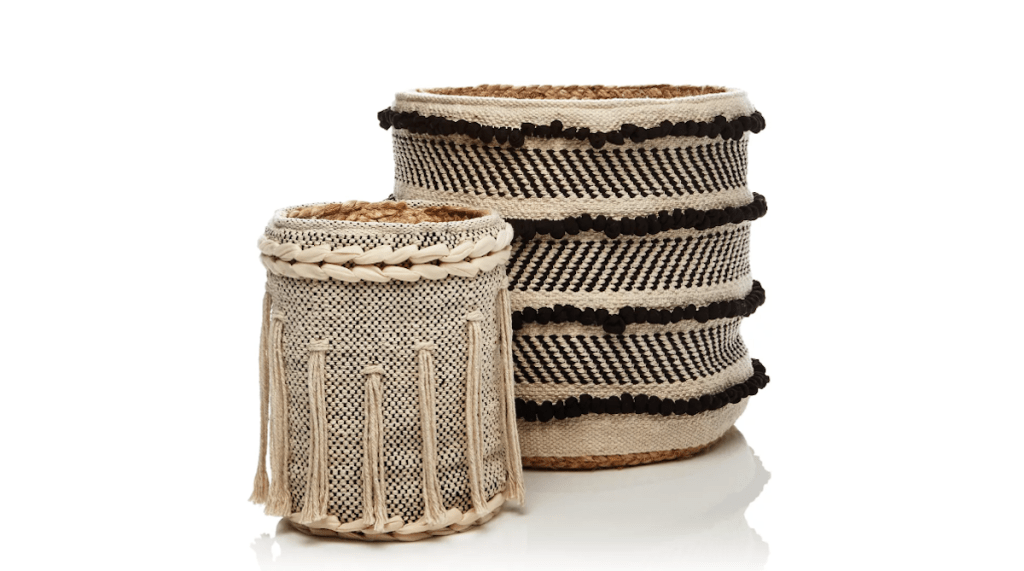 black and white ivory tassel fringe cotton baskets sitting next to each other