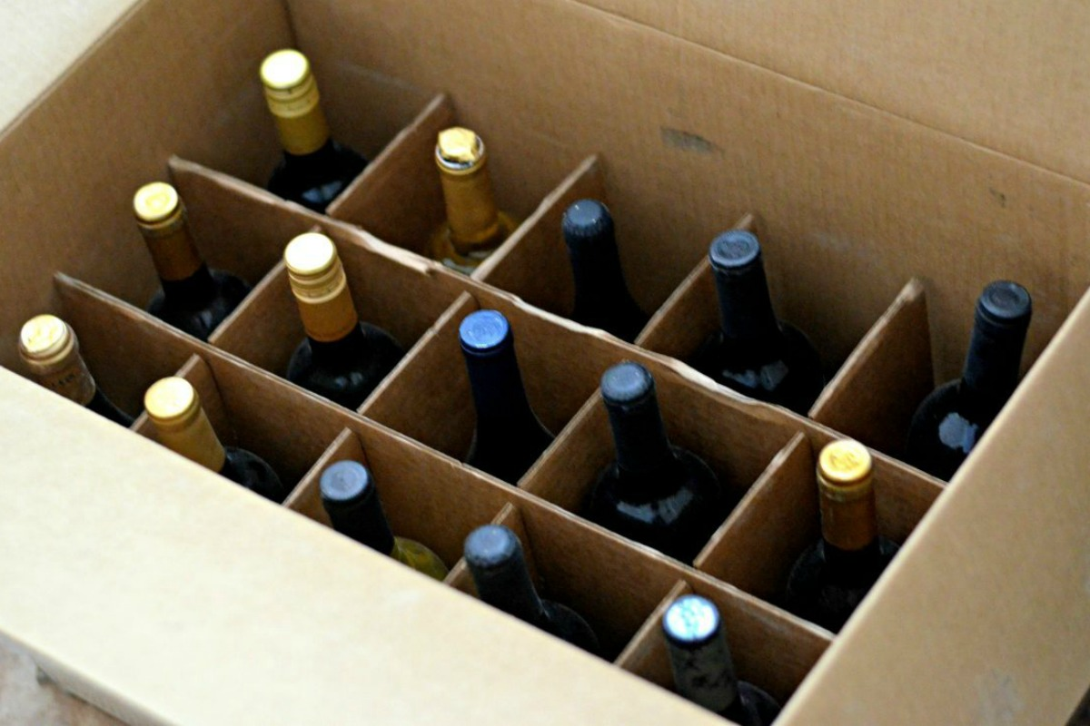 bottles separated in an open cardboard box
