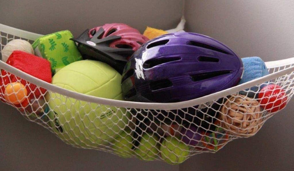 helmets and balls in cream white hammock