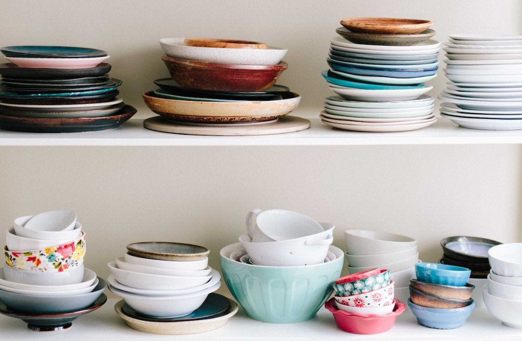 various colors and shapes of dishes plates and bowls