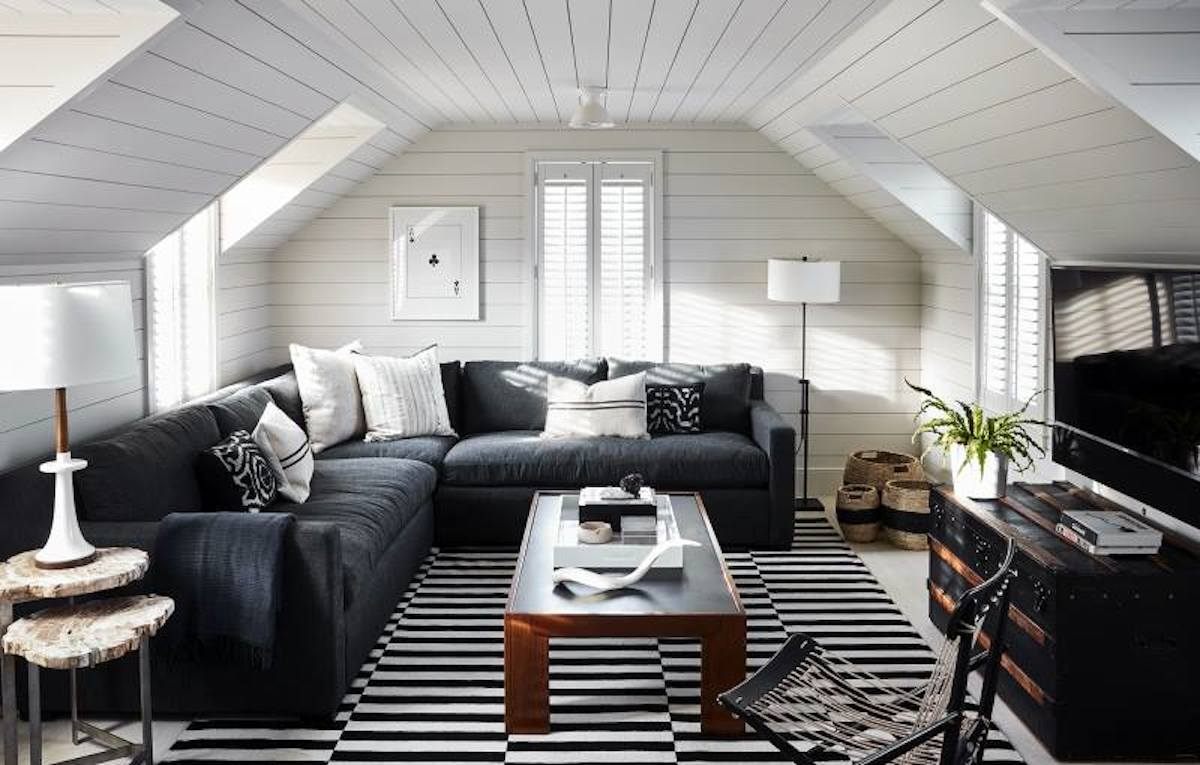 white shiplap walls with charcoal colored sectional couch and TV