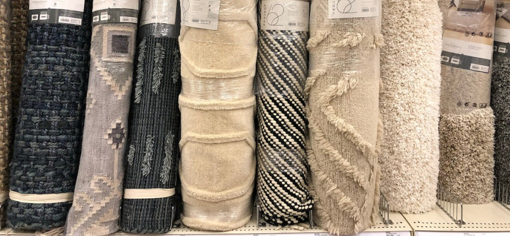 a line of difference neutral colored rugs from blue gray black white beige cream colored