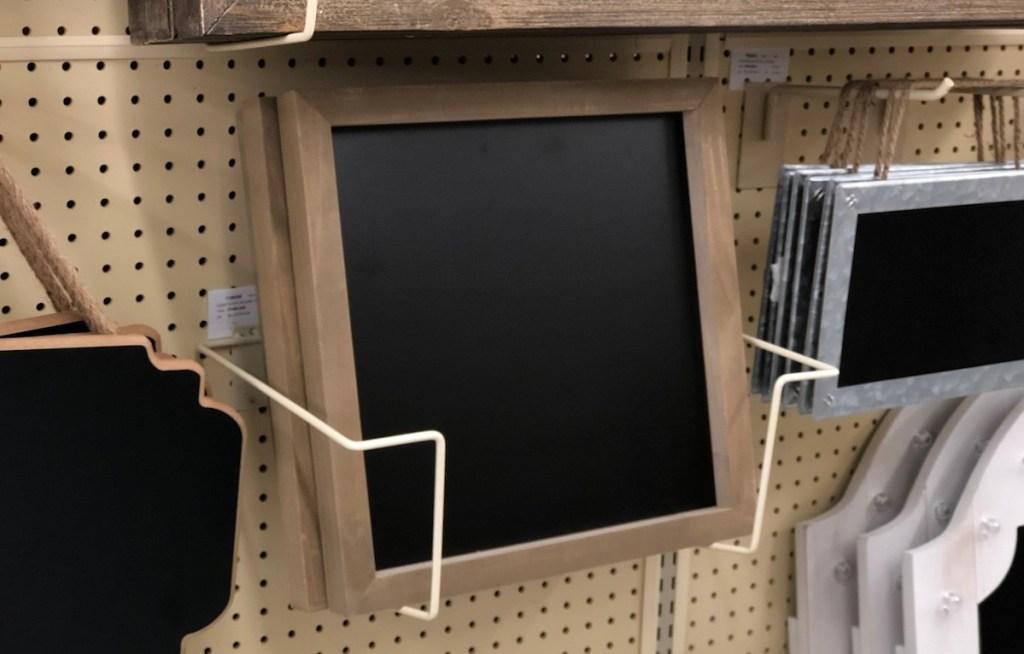 square wood framed chalkboards sitting on shelf