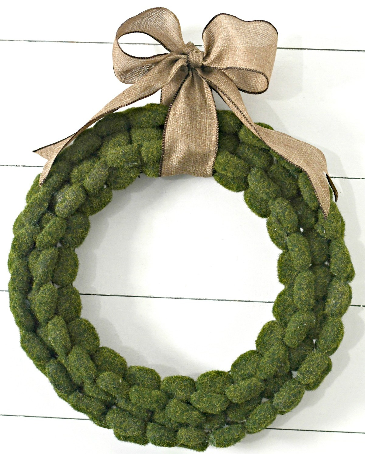 finished and hung up dollar tree moss rock wreath