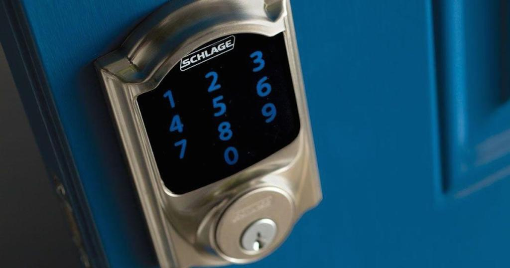 schlage digital lock keypad on a blue door