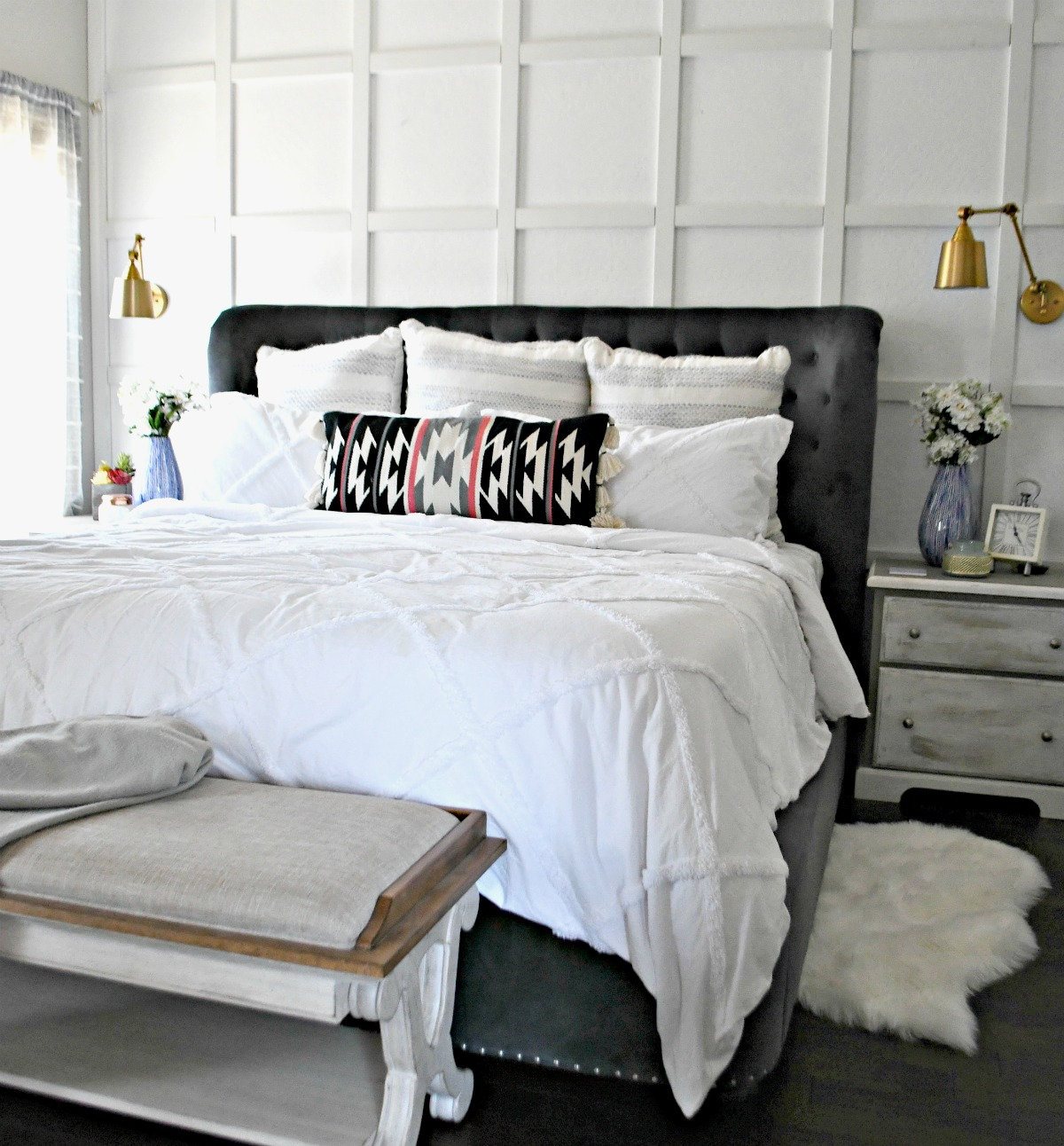 after photo of Lina's room makeover with white walls and white bedding