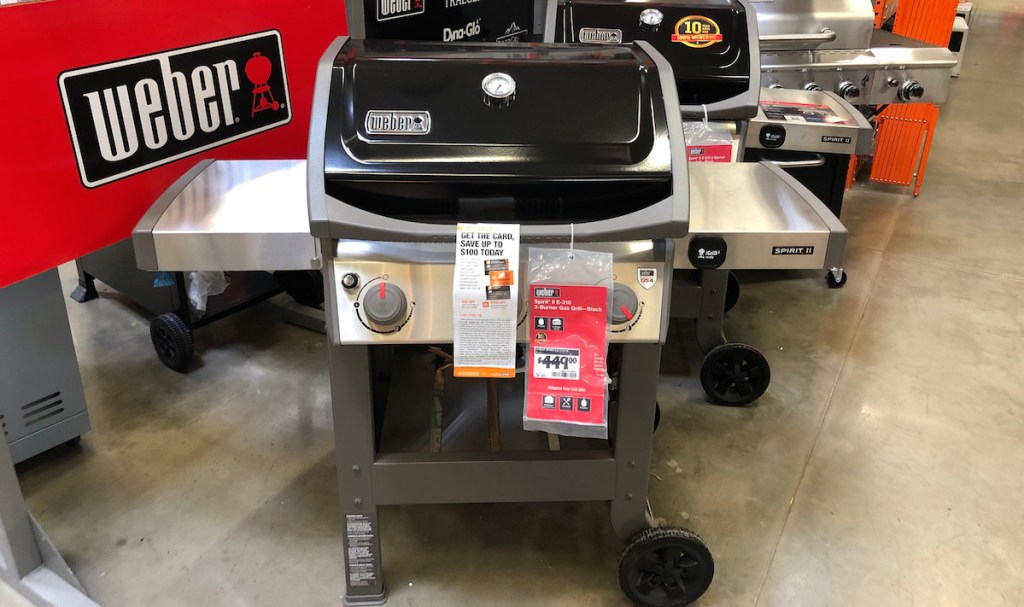 black and stainless steel weber grill in store