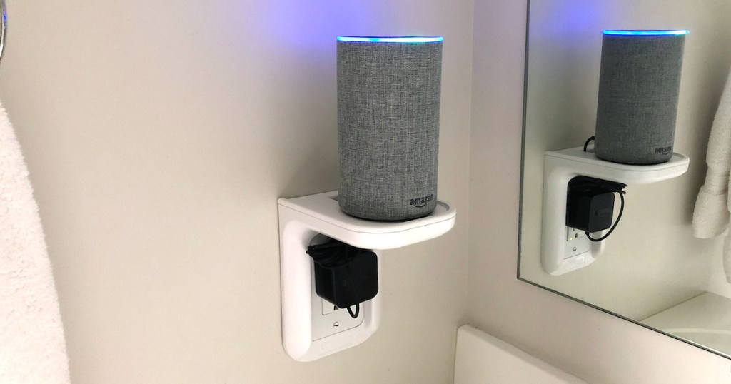 amazon alexa with blue light sitting on white outlet shelf