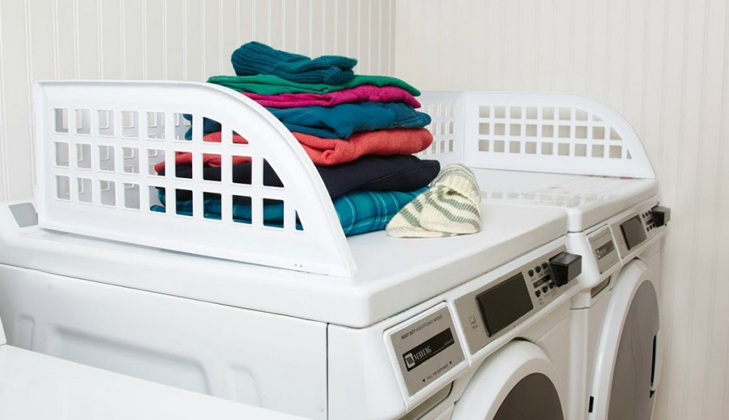white laundry guard on top of washer dryer