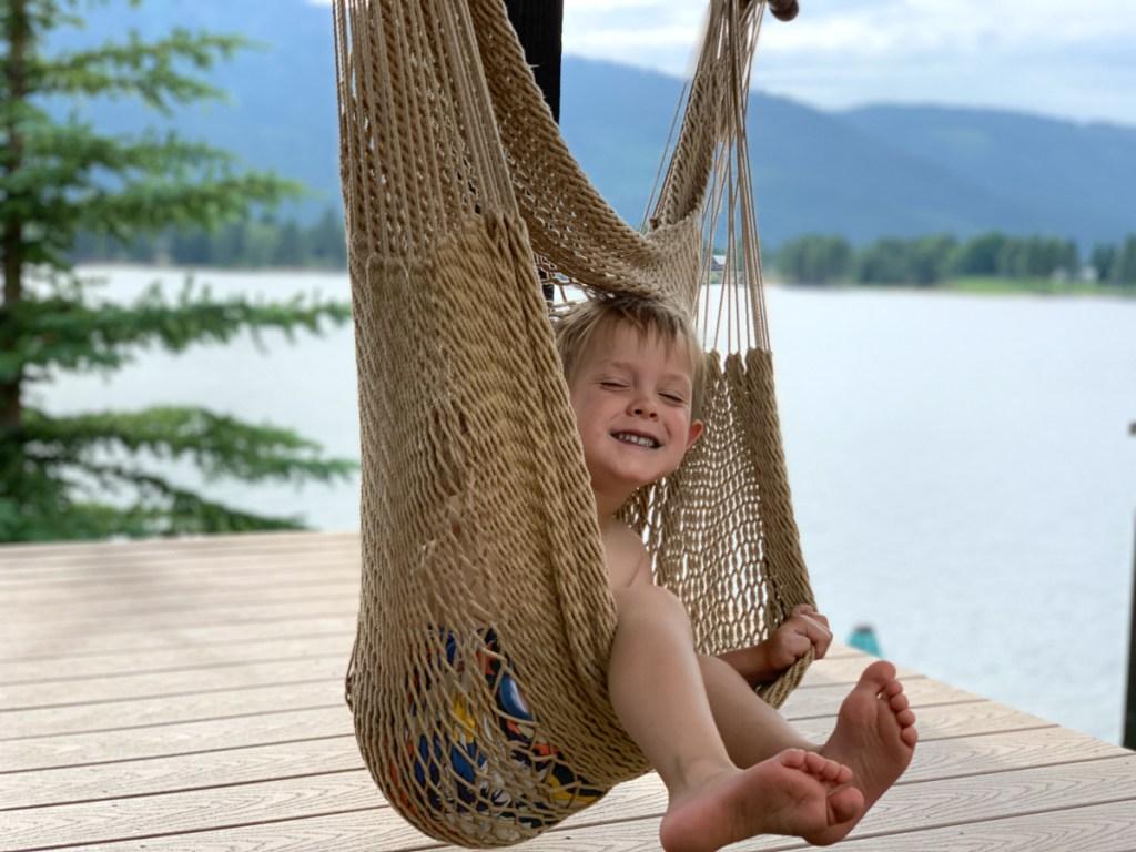 boy sitting in hammock chair