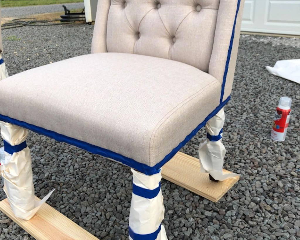 upholstered chair with blue tape on edges outside
