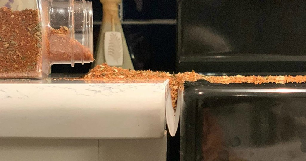 spice spilling on counter top by oven range