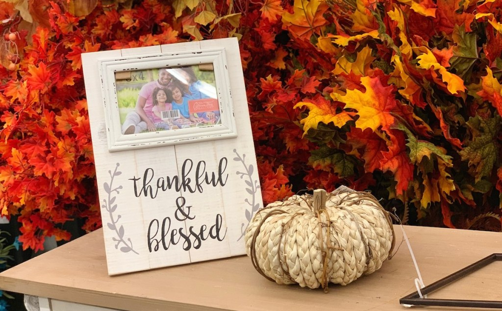 thankful and blessed picture frame and braided cream pumpkin on table