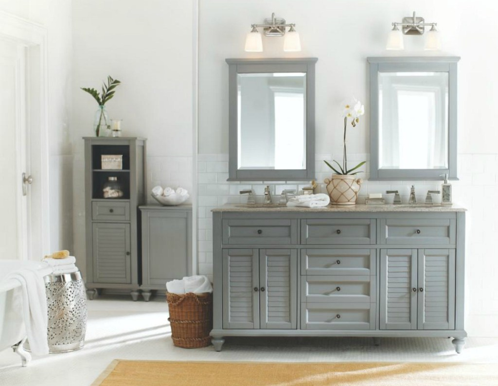 bathroom with gray counter and mirror