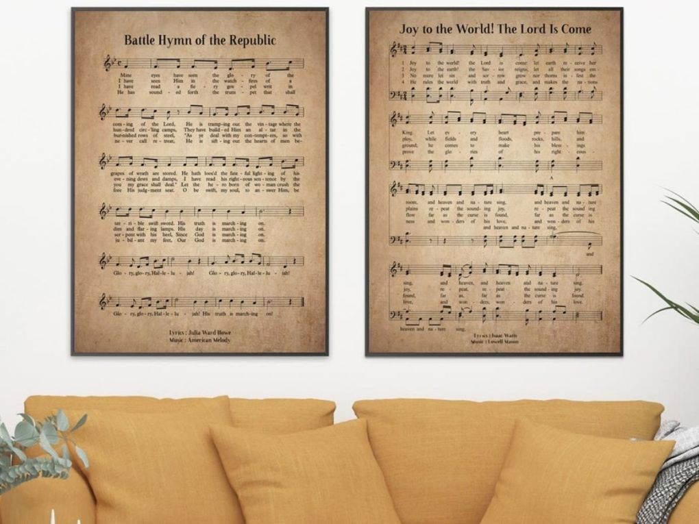 two framed vnatge hymn prints hung over a couch