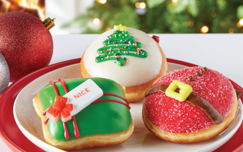 plate with three frosted holiday dougnuts on it