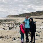 Hip2trek family stood on West Runton beach