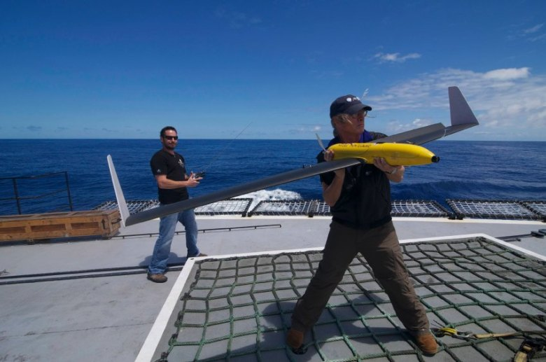 Handout picture of second mate Brown holding a pilotless drone aircraft on the deck of the Sea Shepherd Conservation Society ship, Steve Irwin, off Australia's western coast