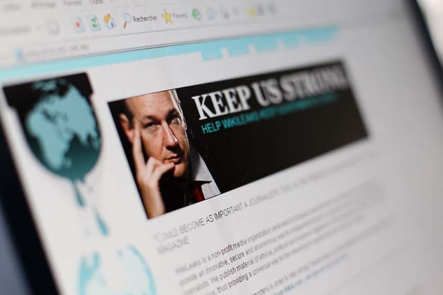 A picture taken on December 3, 2010 in Paris shows a page of the website WikiLeaks featuring its founder Julian Assange. The noose tightened around WikiLeaks as cyber attacks temporarily forced the whistleblowing website off the Internet and its elusive founder Assange faced a fresh arrest warrant. AFP PHOTO THOMAS COEX