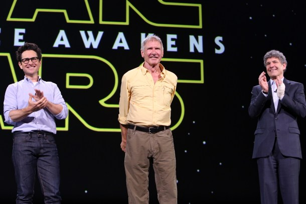 "ANAHEIM, CA - AUGUST 15:  (L-R) Director J.J. Abrams and actor Harrison Ford of STAR WARS: THE FORCE AWAKENS and Chairman of the Walt Disney Studios Alan Horn took part today in ""Worlds, Galaxies, and Universes: Live Action at The Walt Disney Studios"" presentation at Disney's D23 EXPO 2015 in Anaheim, Calif.  (Photo by Jesse Grant/Getty Images for Disney) *** Local Caption *** Harrison Ford; J.J. Abrams; Alan Horn"