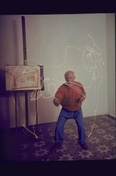 Artist Pablo Picasso attempting to draw a Minotaur w. light pen his home in Vallauris; alone. (Photo by Gjon Mili/The LIFE Picture Collection/Getty Images)