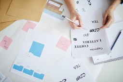 Woman going over different typeface ideas