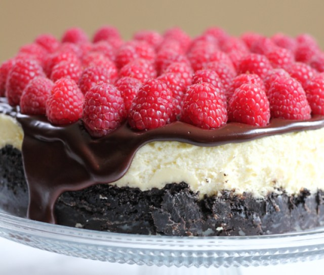Rich Raspberry Cheesecake With Oreo Cookie Crust And Topped With A Delicious Chocolate Ganache And