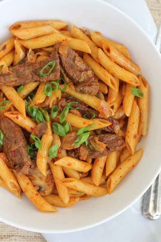 Kimchi lovers will flip over this Spicy Korean Penne Pasta with Beef. #koreanfood #kimchi #pasta #penne