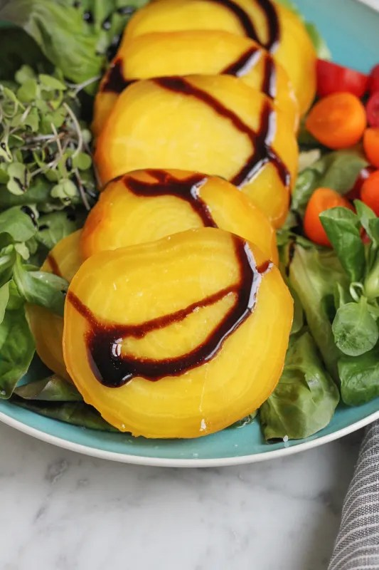 Roasted Golden Beets with Balsamic Glaze - Delicious and beautiful golden beets, oven roasted, and drizzled with extra virgin olive oil and balsamic glaze. These are perfectly roasted beets! You can use them in so many recipes!
