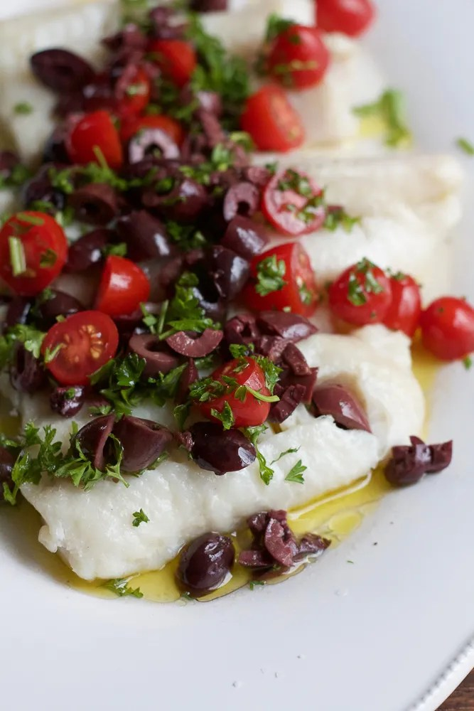 Delicious, flavorful, EASY to make and ready in under 25 minutes, try my Baked Cod with Olive Topping!!!