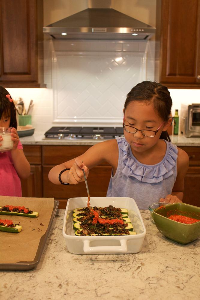 Making Quinoa Stuffed Zucchini Boats.