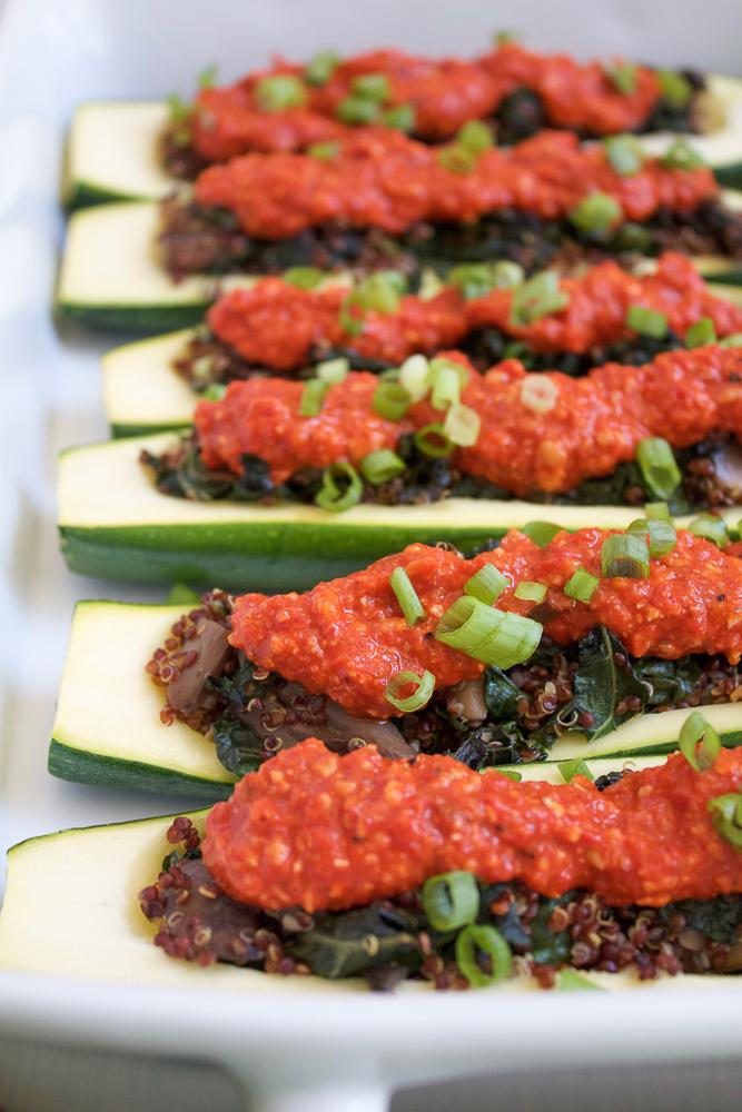 A baking dish with Quinoa Stuffed Zucchini Boats.