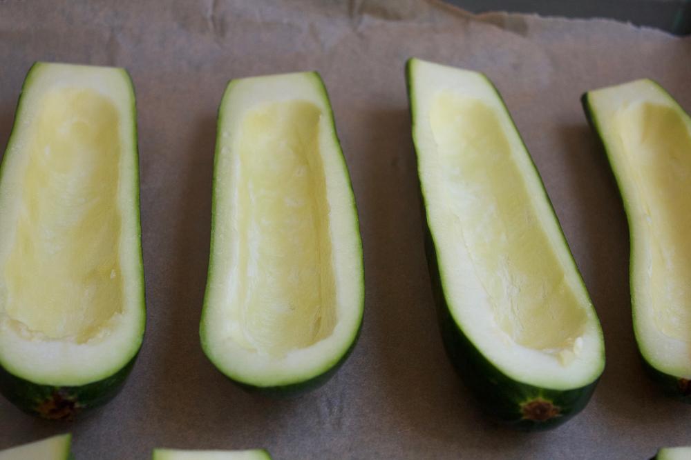 Hollow zucchini halves for Quinoa Stuffed Zucchini Boats.