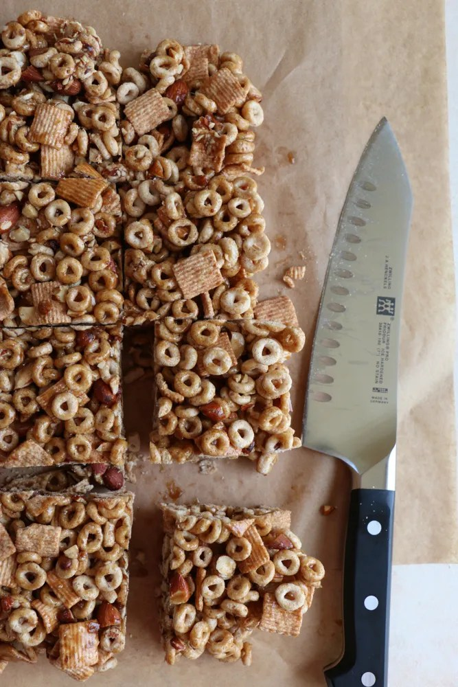 Honey Nut Cereal Breakfast Bars made with our favorite cereals! Cheerios and Cinnamon Toast Crunch! And they are NO BAKE! So easy to make and delicious! The perfect way to celebrate National Cereal Day!